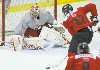 Nathan Denette / the canadian pressTeam Canada forward Connor McDavid is stopped by Selects goalie Andrew Perugini. McDavid wasn�t held off the scoresheet though, netting his team�s first goal.