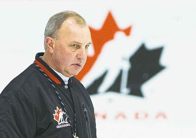 Team Canada head coach Brent Sutter watches a drill during the start of world Juniors selection camp in Toronto on Friday, Dec. 13, 2013. THE CANADIAN PRESS/Nathan Denette