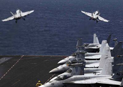 U.S. F/A-18 fighter jets take off for mission in Iraq from the flight deck of the U.S. Navy aircraft carrier USS George H.W. Bush, in the Persian Gulf, Monday, Aug. 11, 2014.