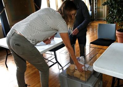 Workers prepare ballots at a polling station at the town hall of Bayonne, southwestern France, Friday, May 5, 2017. France will vote on Sunday May 7 in the second round of the presidential election. (AP Photo/Bob Edme)