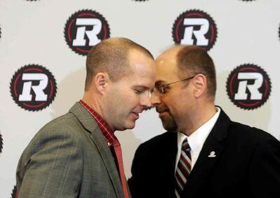 Redblacks general manager Marcel Desjardins (right) and head coach Rick Campbell.