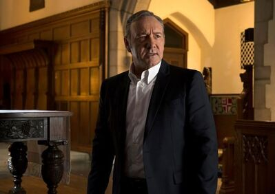 """This image released by Netflix shows Kevin Spacey in a scene from """"House Of Cards."""" Netflix says it's suspending production on """"House of Cards"""" following harassment allegations against Spacey. (David Giesbrecht/Netflix via AP)"""
