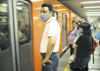MIGUEL TOVAR / THE ASSOCIATED PRESS Commuters wear masks waiting for a subway train in Mexico City Friday.