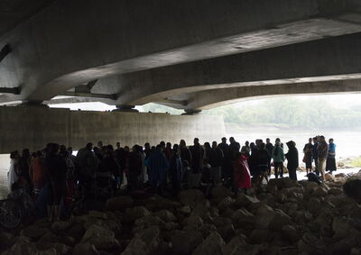 Family and well-wishers gather under the for Provencher Bridge for Faron Hall.