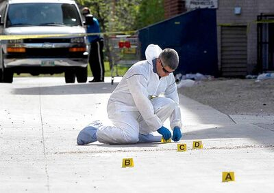 Evidence is collected at the scene of an attack that left a 31-year-old man dead Thursday.