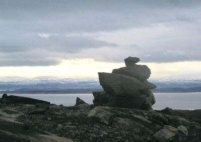 An Inukshuk on the outskirts of Iqaluit overlooks Frobisher Bay.