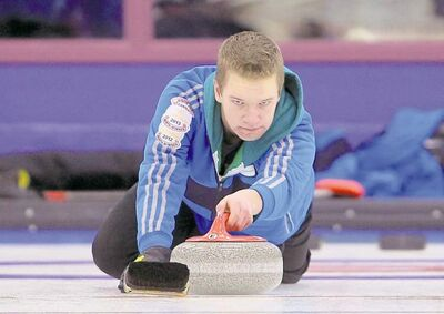 Tim Smith / Brandon Sun Skip Cole Peters throws a rock during his team�s win over Carter Watkins� Swan River rink at the junior provincial curling championships in Brandon on Friday.