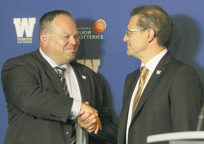Blue Bombers acting CEO Wade Miller is greeted by board chairman Brock Bulbuck at a news conference Friday.
