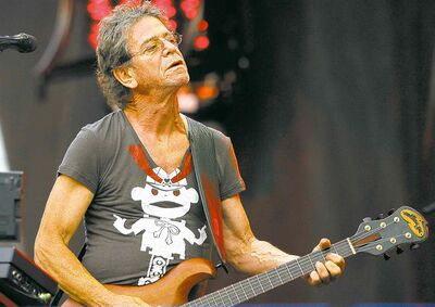 Lou Reed onstage at the Lollapalooza festival in Chicago, Aug. 9, 2009. He was the first to fuse rock with the avant-garde.