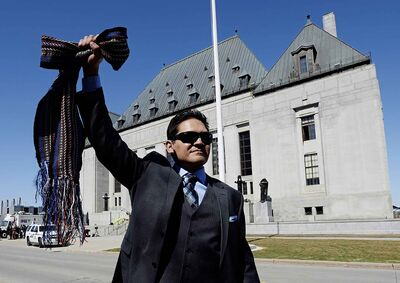 Gabriel Daniels, son of the late Harry Daniels, reacts as he leaves the Supreme Court of Canada in Ottawa on April 14, 2016, following a unanimous ruling that Metis and non-status are Indians under the Constitution. (Sean Kilpatrick / The Canadian Press files)