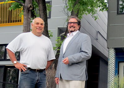 Craig Kitching, left, president of the Corydon Avenue Business Improvement Zone, with Ernie Walter, of Walter International Inc., at 668-670 Jessie Ave.