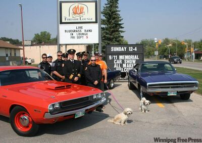 Members of the Springfield Fire and Rescue Service enjoy a memorial car show with their friends from the local community at Peppercorn Restaurant in Oakbank last Sunday.