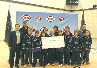 Members of the Norberry-Glenlee 11A2 Knights receive a cheque after scoring big in a recent national contest.
