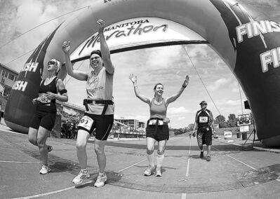Manitoba marathoners celebrate crossing the finishing line in June 2012.