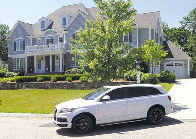 New England Patriots tight end Aaron Hernandez drives from his home late Thursday morning, June 20, 2013, in North Attleborough, Mass. Hernandez had a connection to homicide victim Odin Lloyd, of Boston, whose body was found in an industrial park near the athlete�s home. Family and officials were mum on the nature of their relationship Thursday, two days after police visited Hernandez� home. (AP Photo/The Sun Chronicle, Mark Stockwell) MANDATORY CREDIT. MAGAZINES OUT.