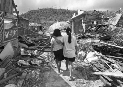Survivors of typhoon Haiyan walk amid ruins in Maraboth, Philippines.