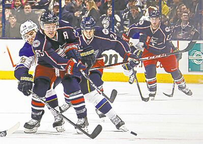 St. Louis Blues winger Adam Cracknell (79) tries to reach in on Columbus Blue Jackets centre Mark Letestu (55) in the first period at Nationwide Arena in Columbus, Ohio, on Saturday, Dec. 14, 2013.