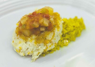 Curry scented couscous with a crab cake and pineapple