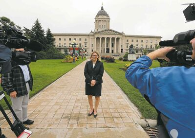 Paula Havixbeck chose to use the backdrop of the Manitoba Legislature to comment on the negative down grade of Manitoba's credit rating, she would also  put a hiring freeze at the city if elected.