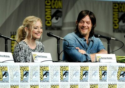"Emily Kinney, left, and Norman Reedus attend ""The Walking Dead"" panel on Day 2 of Comic-Con International on Friday, July 25, 2014, in San Diego. Looking on from left are Chad Coleman and Emily Kinney. (Photo by Chris Pizzello/Invision/AP)"