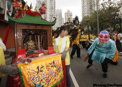Participants carry the statue of Tin Hau, goddess of the sea, during a parade to celebrate her birthday in Hong Kong in May.
