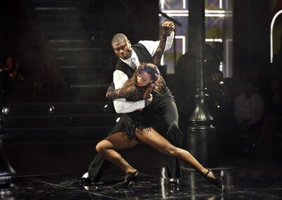 "This May 13, 2013 photo released by ABC shows NFL football player Jacoby Jones and his partner Karina Smirnoff performing on the celebrity dance competition series ""Dancing with the Stars,"" in Los Angeles. Jones is one of four celebrities competing in the finals Monday, May 20. A winner will be announced on Tuesday. (AP Photo/ABC, Adam Taylor)"