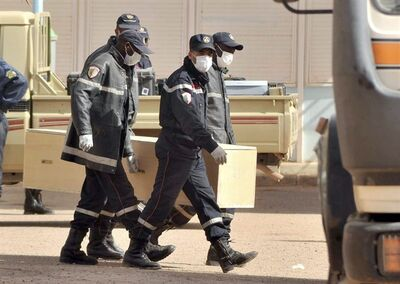 Algerian firemen carry a coffin containing the body of a person killed during the hostage situation in a gas plant at the morgue in Ain Amenas, Monday, Jan. 21, 2013. At least 81 people have been reported dead, including 32 Islamist militants, after a bloody, four-day hostage situation at Algeria's remote Ain Amenas natural gas plant. (AP Photo/Anis Belghoul)