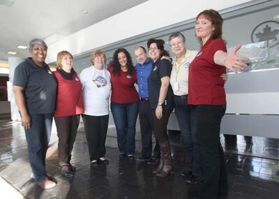 Dreams Take Flight team (L-R): Sharon Zayac, Barb Polson, Rose Anne Seymor, Tara Richter, Chris Isford, Joane Bronk, Bev Watson, and Teresa Toutant. They, and many other Air Canada employees, volunteer their time so kids with disabilities can go to Disney World.