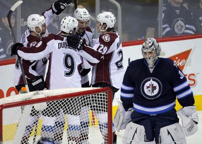 The Colorado Avalanche celebrate Ryan O'Reilly's second-period goal in Thursday evening's game at the MTS Centre.