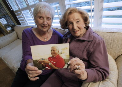 Ben Hatskin's niece, Michelle Rahman, and her mother, Claire Pudavick, hold a picture of Hatskin, the man who brought pro hockey to Winnipeg.