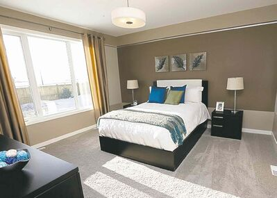 The master suite has ample closte space, a large window and a spa-like ensuite bath loaded with amenities.