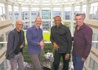 Jimmy Iovine (from left), Tim Cook, Dr. Dre and Eddy Cue at Apple headquarters in Cupertino, Calif., Wednesday.