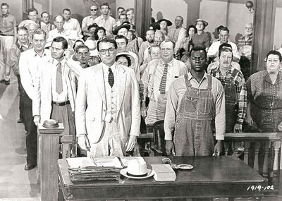 Gregory Peck (left) and Brock Peters star in the 1962 film version of To Kill a  Mockingbird, based on the novel by Harper Lee.