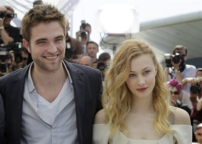 Actors Robert Pattinson, left, and Sarah Gadon pose during a photo call for Cosmopolis at the 65th international film festival, in Cannes, southern France, Friday, May 25, 2012. (AP Photo/Francois Mori)