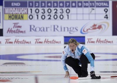 Skip Sherry Middaugh yells to her sweepers on her last shot of the women's semifinal against Rachel Homan Friday. Middaugh defeated Homan 10-4.