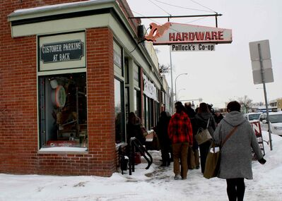 Participants in the Social Purchasing Portal's first annual holiday shopping bus tour enter Pollock's Hardware Co-op. The second tour goes Weds., Dec. 11 at 11:45 am at The Social Enterprise Centre (765 Main St.).