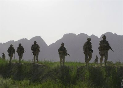 Canadian soldiers patrol an area in the Dand district of southern Afghanistan on Sunday, June 7, 2009. A plan to reduce danger pay for Canadian troops in Afghanistan is now under review by the Harper government.THE CANADIAN PRESS/Colin Perkel
