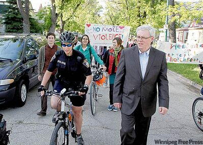 Premier Greg Selinger walks in support of the residents' cause to reclaim the community from street gangs.