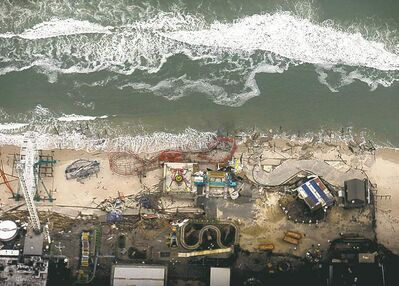 Alex Brandon / The Associated PressDebris from an amusement park destroyed by superstorm Sandy lines the beach in Seaside Heights, N.J. U.S. President Barack Obama toured the area Thursday.