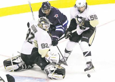 John Woods / THE CANADIAN PRESS archivesPittsburgh goaltender Tomas Vokoun and defenceman Kris Letang team up on left-winger Evander Kane during third-period action Friday night.