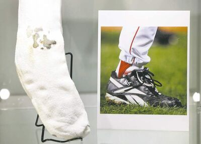 Seth Wenig / the associated pressThe bloody sock worn by former Boston Red Sox pitcher Curt Schilling in Game 2 of the 2004 World Series is displayed at Heritage Auctions in New York.