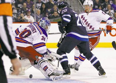 John Woods / the canadian pressThe Jets� Antti Miettinen (20) pots one against Rangers goaltender Henrik Lundqvist (30) during second-period NHL action at the MTS Centre Thursday.