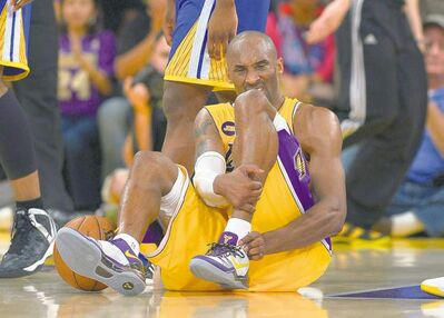 Mark J. Terrill / the associated pressLos Angeles Lakers guard Kobe Bryant grimaces after being injured during the second half of their NBA basketball game against the Golden State Warriors,