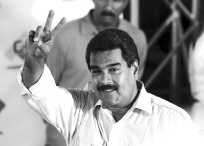 Nicolas Maduro flashes a victory sign after voting Sunday.