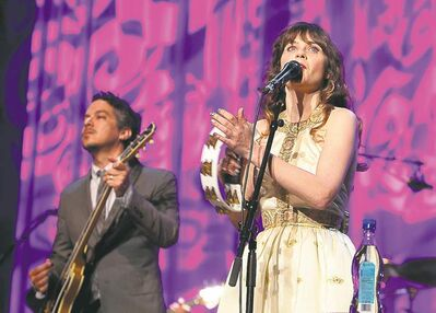 Zooey Deschanel performs with her musical partner M. Ward in She & Him