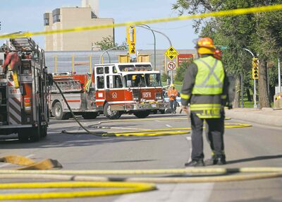 Ruth Bonneville / Winnipeg Free PressEmergency crews block traffic in both directions near Main and Higgins after power lines caught fire beneath the street.