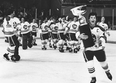 Winnipeg Jets captain Lars-Erik Sjoberg carries the Avco Cup after the Jets beat the Edmonton Oilers 7-3 to capture the final WHA championship four games to two in Winnipeg, Manitoba, in this May 20, 1979 photo.