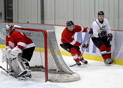 Players are shown in action at last year's Hockey Manitoba Cup.