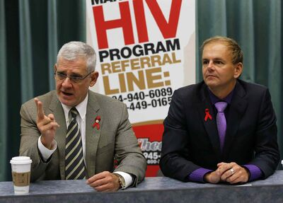 Dr. Ken Kasper (right), with Dr. Julio Montaner, says up to 60 Manitoba HIV patients annually end treatment due to finances.