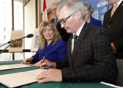 Shelly Glover Minister for Canadian Heritage  and Official Languages, Left, with Stan Struthers, provincial minister of municipal government, sign a Gas Tax Fund agreement stabilizing funding for public infrastructure in Manitoba.